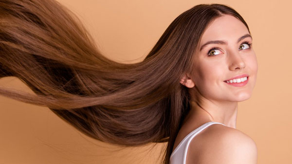 Long and shiny hair is a sign of good health and fertility in women