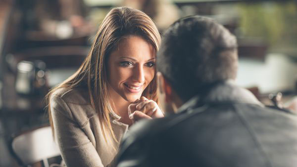 signs a woman is attracted to you body language